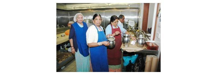 ladies preparing food in the kitchen at GHS